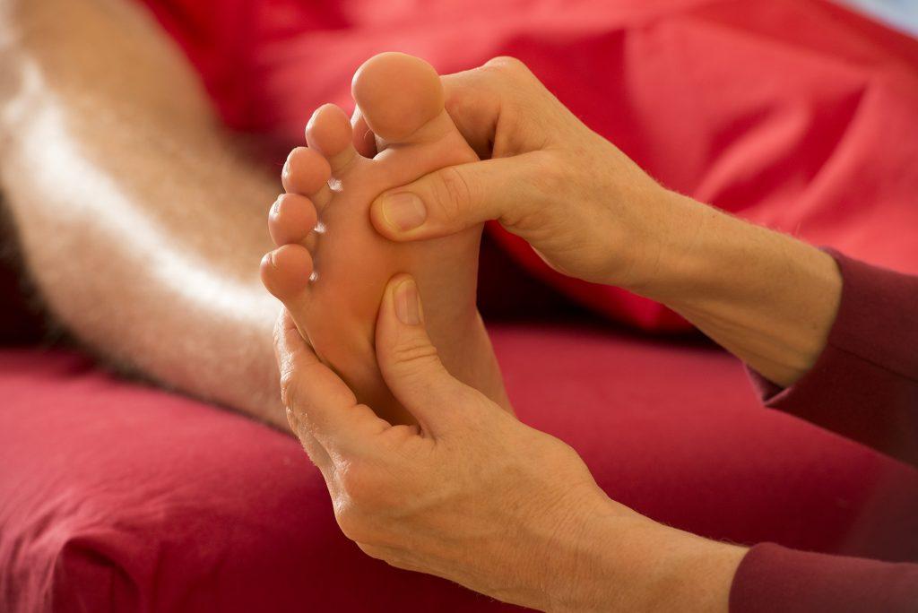 Massage eines Fußes